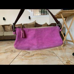 Small magenta suede shoulder bag by Coach